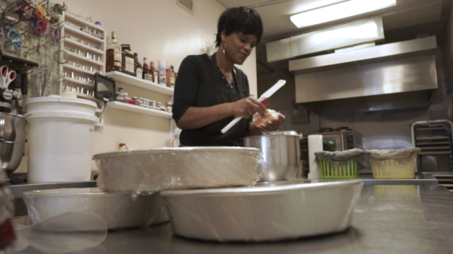 Evette Rahman adds butter to a dessert mix at her bakery Sister Honey's in the SoDo District in Orlando.